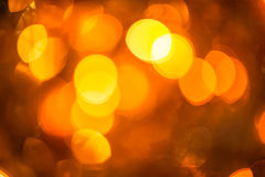 Festive bokeh lights. Festive winter gold abstract. background with bokeh lights Royalty Free Stock Photos