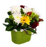 Festive bouquet of flowers in a wicker basket on white backgro stock photo