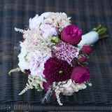 Festive bouquet of red roses and gypsophilas Royalty Free Stock Images