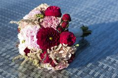 Festive bouquet of red roses and gypsophilas Royalty Free Stock Image