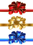 Festive bow. Luxury holiday bow of blue, gold and red on a white background Royalty Free Stock Photo