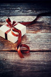 Festive Box Brown Ribbon on Wooden Background Royalty Free Stock Image