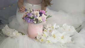 Festive box with flowers on the white dress stock footage