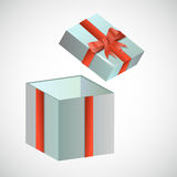 Festive box with red retro bow. On a light background Royalty Free Stock Photography