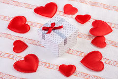 Festive box surrounded by soft hearts Royalty Free Stock Photography