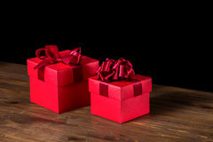 Festive boxes with bow on wooden background is  Stock Photos