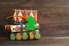 Festive boxes in colourful paper with a decorative New Year tree Royalty Free Stock Photos