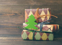 Festive boxes in colourful paper with a decorative New Year tree Royalty Free Stock Image