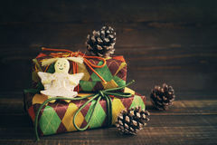 Festive boxes in colourful paper and a toy angel Royalty Free Stock Image