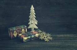 Festive boxes in colourful paper with a wooden decorative New Year tree Royalty Free Stock Image