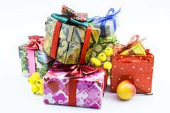 Festive boxes of different colors and a red bag close-up on a white. Boxes with gifts for the holiday isolated on a white background royalty free stock photography