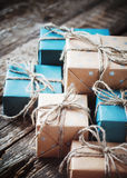 Festive Boxes with Linen Cord. Color Gifts. On Wooden Background stock images