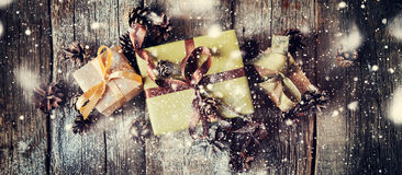 Festive Boxes on Wooden Table. Drawn Snow. Web design Royalty Free Stock Image