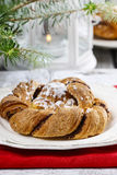 Festive braided bread on wooden table Stock Photo