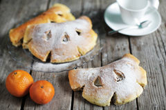 Festive bread buns filled with citrus cream, coffee time. Teatime snack with satsumas Stock Photos
