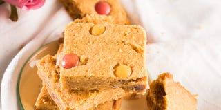 Festive breakfast peanut butter bownies on pastel. Banner Stock Photo