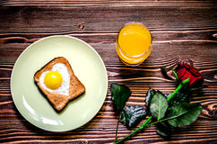Festive breakfast Valentine`s Day. Breakfast consists of toast and juice. Inside toast fried egg in the form of a heart. Stock Photo