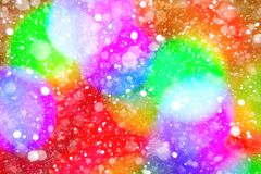The colorful spots bokeh effect and snowflakes Stock Images