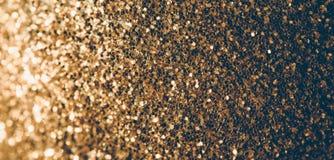 Festive shiny background. Golden glitter. Festive bright decorative background. Shiny yellow glitter stock photography