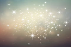 Festive bright lights background. Shiny brownish grey background with star lights explosion Royalty Free Stock Photo