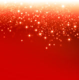 Festive bright lights background. Shiny red Christmas background with star lights falling down Royalty Free Stock Image