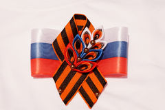 Festive brooch with a St.George`s Ribbon Stock Photo