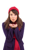 Festive brunette blowing over hands Royalty Free Stock Image