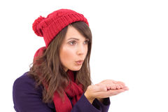 Festive brunette blowing over hands Stock Photography