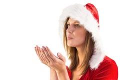 Festive brunette blowing over hands Stock Images