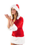 Festive brunette blowing over hands Stock Photo