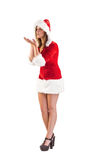 Festive brunette blowing over hands Royalty Free Stock Photo
