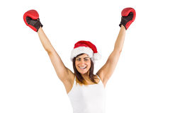 Festive brunette in boxing gloves cheering Royalty Free Stock Images