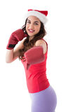 Festive brunette in boxing gloves punching Stock Photography