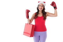 Festive brunette in boxing gloves with shopping bag Royalty Free Stock Photos