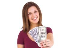 Festive brunette in dress showing her cash Stock Image