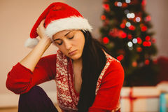 Festive brunette feeling sad at christmas Stock Photos