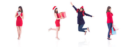 Festive brunette holding gift bags Stock Photos