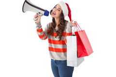 Festive brunette holding gift bags and megaphone Royalty Free Stock Photos