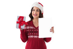 Festive brunette holding gift and showing paper Stock Photos