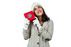 Festive brunette holding a gift Royalty Free Stock Image