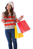 Festive brunette holding gifts and thumb up Royalty Free Stock Photos