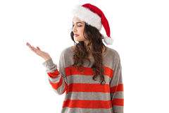 Festive brunette holding hand out Royalty Free Stock Photos