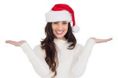 Festive brunette holding hands out Stock Image