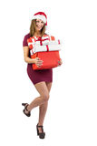 Festive brunette holding pile of gifts Stock Images