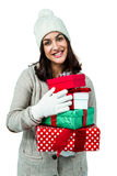 Festive brunette holding pile of gifts Stock Photos