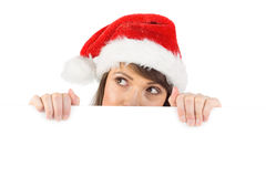 Festive brunette holding a poster while looking up Stock Photos