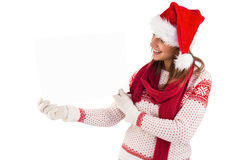 Festive brunette holding a poster Royalty Free Stock Image