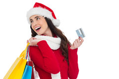 Festive brunette holding shopping bags and credit card Stock Photo