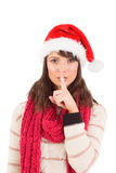 Festive brunette keeping a secret Stock Photo