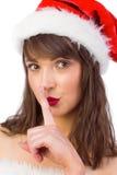 Festive brunette keeping a secret Stock Images